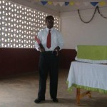 Hammer preaching in Vogan Christian Church